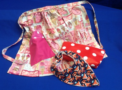 Hand sewn apron and other items in fabric