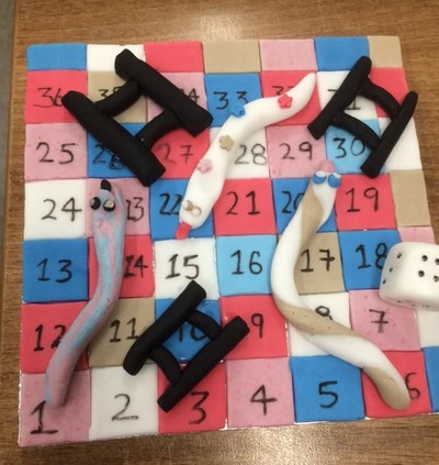 Snakes and Ladders cake topper