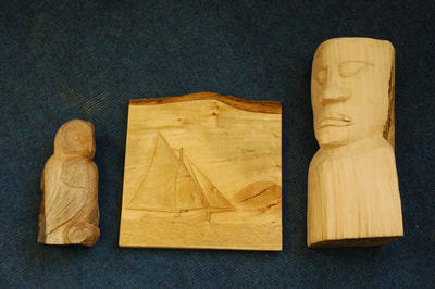 Woodcarved pieces from St Colmcille's Community School Adult Education programme